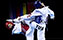 TAEKWONDO-Hwang Kyung-Seon (left) of South Korea and Nur Tatar (right) of Turkey both land kicks during the women's -67kg category final at the London 2012 Olympic Games
